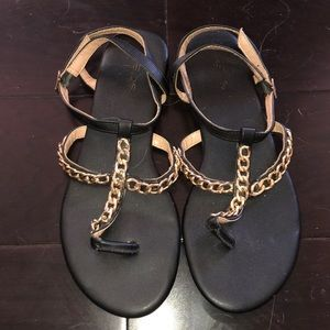 Black sandals with gold chains bebe